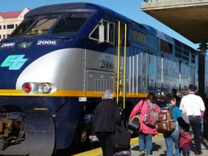 Amtrak San Joaquins at Emeryville station in 2012. The locomotive is wearing Amtrak's California logo by Hornswoggle via Wikimedia Commons