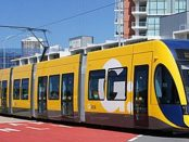 A Flexity 2 tram leaving Broadwater Parklands on the Gold Coast Light Rail by David Ansen via Wikimedia Commons